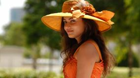 Sneha Ullal In Orange Dress N Orange Hat Side Pose Photoshoot